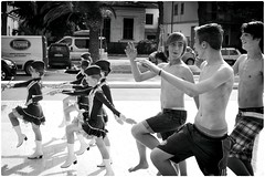 Untitled (Steve Lundqvist) Tags: innocence boys playing cheerleader joking impression doing joke play band banda parade girls nikon italy street streetphotography imitazione italians youth age festival carnaval pompomgirl defiler majorette fun funny