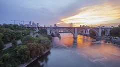 Minneapolis Sunset (Sam Wagner Photography) Tags: minneapolis minnesota bridges mississippi river mighty blue long exposure motion blur wide angle midwest architecture skyline 35w stone arch traffic cityscape hour twilight 4k timelapse