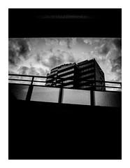 stripedview (seba0815) Tags: ricohgrdiv grdiv grd monochrome architecture building walk stripe sky clouds dark evening urban street framed pov view contrast dramatic mood seba0815 bw black white bianco nero blanc noir blackwhite blackandwhite schwarzweis czarnobiale