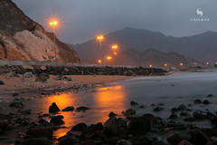 Just before Sunrise (hisalman) Tags: sunrise longexposure alaqqa beach lights night morning sun water mountains