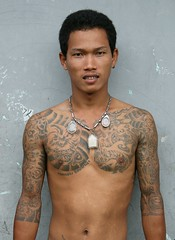tattoos and amulets (the foreign photographer - ฝรั่งถ่) Tags: young man tattooed tattoos amulets khlong thanon portraits bangkhen bangkok thailand canon kiss