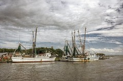 With each week that passes... The Lady Eva (John E Adams) Tags: shrimpboats shemcreek southcarolina moored water pier sky cloud vintage wood boats