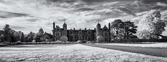 Elizabethan splendour (David Feuerhelm) Tags: nikkor blackandwhite monochrome bw panorama contrast sky house building towers old historic windows trees infrared ir silverefex kentwellhall suffolk england nikon d90 wideangle