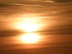 Clouds Split Up The Sun (Tassos Giannouris) Tags: sun sunset set sky zoom clouds split orange cloudy