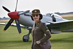 Two Beauties (Steve.T.) Tags: flyinglegends spitfire supermarinespitfire duxford iwmduxford reenactor waaf ww2 girlinuniform nikon d7200 sigma18200 sunglasses shades pose posing pinupgirl redlipstick englishrose