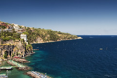 Golfo di Sorrento (Italy) (Andrea Moscato) Tags: andreamoscato italia view vista vivid mare sea seascape seashore spiaggia water acqua rock blue white sky cielo scogliera landscape paesaggio nature natura people day light shadow deep cliff buildings