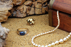 Still Life With Jewellery (andycurrey2) Tags: smileonsaturday jewels ring outdoor sand driftwood saphire necklace pearls gold treasure shell seaside chest box art canon digital
