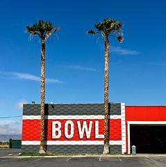 Bowl (Maureen Bond) Tags: bowl bowling two palms desert ca maureenbond red darkgray brick letters stripes white palmtrees bowlingalley game buidling palmfrawns iphone splitpins