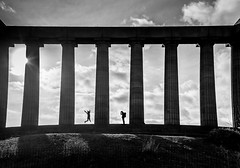 Jumping for Joy Edinburgh. (James- Burke) Tags: backlighting blackandwhite bw candid contrejour edinburgh edinburghmemorial fuji fujixt1 jumping monochrome people photographer scotland silhouettes street streetphotography streetphotographer