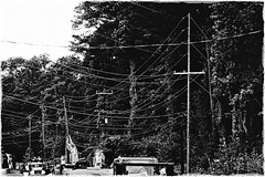 Wires Along Lower Roswell Road | Marietta, Georgia (steveartist) Tags: posterizedimage wires utilitywires telephonewires trucks roadbuildingequipment trees poles sonydscwx220 stevefrenkel mariettageorgia