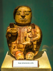 A woman and child as part of artwork at the Chacas museum.