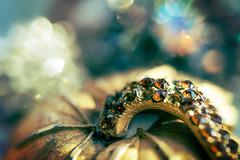 Missing jewels (borealnz) Tags: brooch broken macro macromondays jewellery jewel bokeh missing gold treasured old paste costumejewellery
