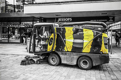 Worker bee (tootdood) Tags: canon70d blackandwhite monochrome manchester market street streetcandid people sitting sit sat seated selective colour worker bee road sweeper jessops