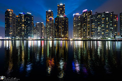 Marine city (geirchristensen) Tags: busan haeundae marinecity korea night skyline cityscape towers building buildings lights sea ocean reflection