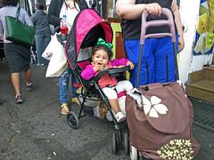 BostonGirlwithGreenRibbon (fotosqrrl) Tags: boston massachusetts streetphotography urban haymarket blackstonestreet stroller cart