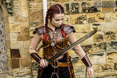 IMG_9485.jpg (Neil Keogh Photography) Tags: silver whitbygothweekend steampunk sword shoulderguards viking brown steampunkdress armguards red warrior goth armour blouse whitby top female woman whitbygothicweekendapril2017 facepaint black gothic trousers leather waistcoat white
