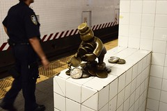 Penny Pincher (-»james•stave«-) Tags: newyork nyc manhattan city urban subway sculpture whimsical statue bronze man pennies coins art artist tomotterness lifeunderground cop police nypd platform mta nikon d5300