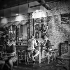 The Bar - Benson Brewery - Benson, NE (vwcampin) Tags: iphoneography iphoneographer iohoneology iphoneology converse talking conversation drunk drinking omaha stool man historic vintage old brick blackandwhite beer drinks men bar bensonbrewery nebraska brewery benson