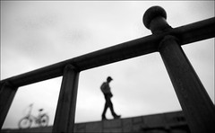 F_47A0036-1-BW-Canon 5DIII-Canon 16-35mm-May Lee 廖藹淳 (May-margy) Tags: maymargy bw 黑白 人像 腳踏車 剪影 模糊 散景 欄杆 街拍 streetviewphotographytaiwan 天馬行空鏡頭的異想世界 mylensandmyimagination 線條造型與光影 linesformandlightandshadows 心象意象與影像 naturalcoincidencethrumylens humaningeometry birdislet penghucounty taiwan repofchina 鳥嶼 澎湖縣 台灣 中華民國 幾何構圖 f47a00361bw portrait bicycle silhouette blur bokeh rail canon5diii canon1635mm maylee廖藹淳 孤獨的儀式