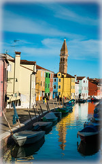 Burano (JDWCurtis) Tags: burano venice venezia italy water waterway waterfront reflection colour colours colourful boat tower church italian riverfront canal houses street holiday solo leaningtower frame framed