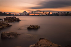 Sydney Sunset (mclcbooks) Tags: sydneyoperahouse harborbridge sydney newsouthwales australia nsw harbor ocean bay water sunset evening sky clouds rocks longexposure le cityscape landscape
