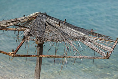 Sunshade-20170603-3155 (old.pappous) Tags: crete kalami soudabay beachumbrella broken disintegrating reedcanopy rotted rotten sunshade greece gr