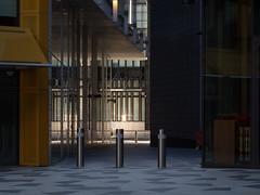bollards (Cosimo Matteini) Tags: cosimomatteini ep5 olympus pen m43 mft mzuiko60mmf28 london city cityoflondon squaremile ludgatehill architecture reflection fragmented bollards