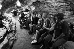 Cave Tour (timvandenhoek1) Tags: cave marktwaincave hannibalmissouri ruralmissouri missouri midwest countryside labyrinth maze cavern blackandwhite tour tourguide underground depths abyss rock limestone path beckythatcher tomsawyer huckleberryfinn huckfinn injunjoe sigma19mmf28emount sonyilce6000 timvandenhoek