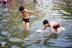 Raining Happiness (Shikher Singh) Tags: boys rains pond water play kids indiagate newdelhi fun aqua smile laugh happiness joy glee soaked shikher'simagery summer leisure recreation motion child