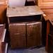 Low door dark wood stained storage