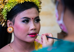 A woman applying makeup to a teenage girl in traditional costume before a tooth filing ceremony, Bali island, Canggu, Indonesia (Eric Lafforgue) Tags: adults asia asian bali bali2121 balinese barong beliefs canggu ceremony clothing colorimage customs filing headshot hindu hinduism horizontal indigenouspeople indonesia indonesian indonesianculture indoors makeup mesangih realpeople rite rites ritual spiritual toothfiling tradition traveldestination womenonly baliisland