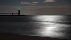 Beach beacons (Notkalvin) Tags: manistee michigan lighthouse breakwall pier notkalvin mikekline longexposure outdoor beach beacons lakemichigan reflection water notkalvinphotography clouds moon moonlight night