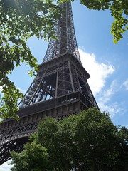 La Tour Eiffel (LadyRaptor) Tags: la tour eiffel tower wrought iron metal structure monument sculpture heritage gustaveeiffel france french europe european city paris parisian summer blue sky white clouds trees branches leaves sun shine shining bright sunny rays monumenthistorique 1889 expositionuniverselle worldsfair