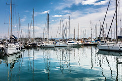 Busy (on the eye) (clive_metcalfe) Tags: yacht harbour marina greek corfu gouvia reflections clouds sky mast