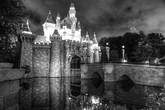 Imagination (KC Mike D.) Tags: park disneyland castle amusement disney monochrome matterhorn sleepingbeauty waltdisney fantasyland mainstreet moat drawbridge people selfie reflection flags