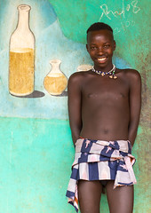 Young Bana tribe boy in front of a painted mural for tej drink in a bar, Omo valley, Key Afer, Ethiopia (Eric Lafforgue) Tags: abyssinia advertisement advertising africa african africanculture billboard candid colourpicture day developingcountry drink eastafrica ethiopia ethiopia0617251 ethiopian hornofafrica humaninterest keyafer lookingatcamera men mural muralpainting omovalley onemanonly oneperson oneteenageboyonly painting portrait smiling teenager tej tribal tribe tribesman vertical waistup wall youngman et