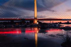 Riverside view (Master Iksi) Tags: river riverside bridge sky clouds sunset reflection urban architecture belgrade serbia srbija beograd nikond7100 sigma1750 dark light sava peaceful