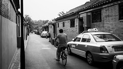 I don't need a taxi (Go-tea 郭天) Tags: pékin beijingshi chine cn beijing hutong gulou byke bicycle car taxi old new school ride riding rider sport transportation movement traditional tradition history historic historical ancient narrow alley road buildings house construction through man alone lonely parked side back backside candid bricks wall day street urban city outside outdoor people bw bnw black white blackwhite blackandwhite monochrome naturallight natural light asia asian china chinese canon eos 100d 24mm prime cab