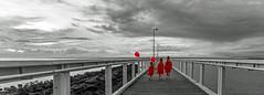 A Splash of Red (Beth Wode Photography) Tags: wellingtonpoint wellingtonpointjetty blackwhite selectivecolour 3littlegirls reddresses redballoons portraiture