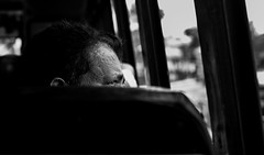 Observe (relishedmonkey) Tags: nikon d5300 watch man eyes iris look face expression travel india kerala 35mm 18g black white monochrome seat design lines day outdoor bus vehicle one person street