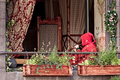 Piper In A Red Hood (k009034) Tags: 500px red people street flower travel window house old architecture building playing chair garden rose town flora wooden hood medieval decoration curtain box piper flute tallinn estonia copy space destinations teamcanon
