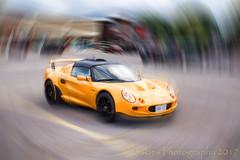 Swirl (HSS) (13skies) Tags: car sportscar yellow yellowcar fast small sporty effect slider slidersunday happyslidersunday coollooking cool parkinglot sony sonya57 lotus