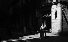Painting the light (elgunto) Tags: street people elborn barcelona contrast light shadows dark monochrome sunlight painter blackwhite bw sonya7 pentax 40mm28 pancake manuallense