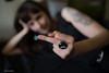 giving the finger (sami kuosmanen) Tags: suomi finland kuusankoski kouvola girl woman tyttö north nainen europe expression beautiful kaunis photography people party ihminen dof dark bokeh tattoo tatuointi sormus ring