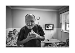 The duck is my best friend (Jan Dobrovsky) Tags: leicaq blackandwhite portrait reallife human document handicapped mentally contrast grain duck indoor care