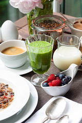 Breakfast with green smoothie and berries (vas_eka) Tags: hautecuisine natural morninglightening berries cutlery milk tableware holiday granola diet morning smoothie nutrition countryside cooked tablesetting peonies design outdoor meal windowlight gourmet organic cuttedflowers homemade lifestyle beverages resort flowers decor jar cooking detox breakfast table earlymorning cereals healthy hotel garden tabledecorations seasonal food restaurant nutrients stylish blueberry raspberries strawberries wellness green fruits nourishment chef rustic