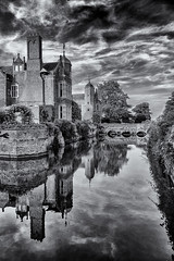 Reflections of Kentwell (David Feuerhelm) Tags: blackandwhite monochrome nikkor bw contrast sky clouds moat reflection water building history old brickwork windows drama wideangle kentwellhall suffolk silverefex trees nikon d750
