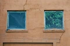 Abandoned (Gabby Pike) Tags: film photography analog old weathered aged cracked peeling paint windows doors door window abandoned canon ae1 kodak ektar 100 broken