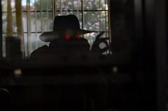 The Spy (MPnormaleye) Tags: suspense mystery weird strange fantasy silhouette hat hand shadows utata lensbaby 56mm seeinanewway bizarre