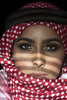 The wind is in your voice (DesertWindsPhotography) Tags: red white black love makeup art photography green eyes eyebrows culture tradition arabia saudi qatar bahrain kuwait emirates desert women veil عيون السعودية الكويت الإمارات الشماغ احمر